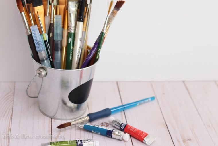 watercolor paint brushes in a bucket
