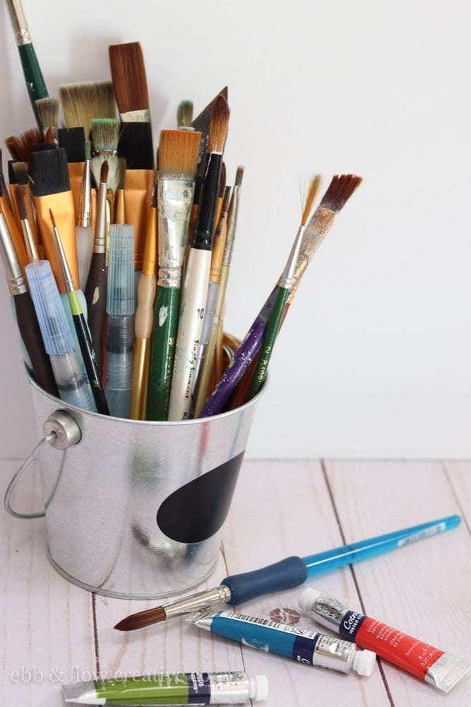 bucket of paint brushes