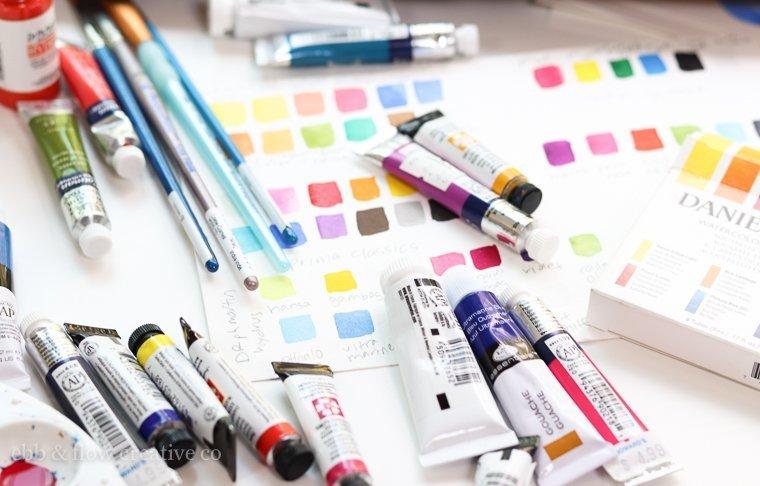 watercolor paints on a desk