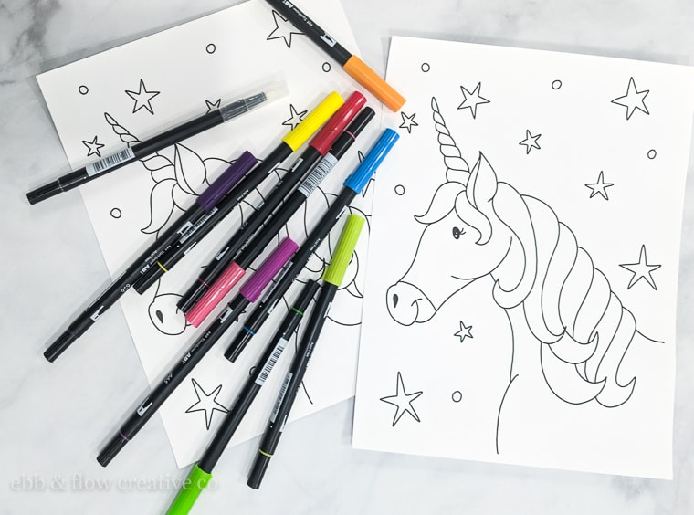 printed unicorn coloring page with markers