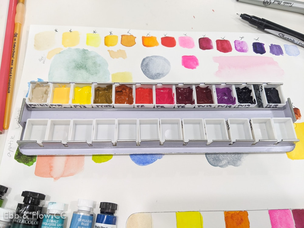 filling a pan with watercolor paint