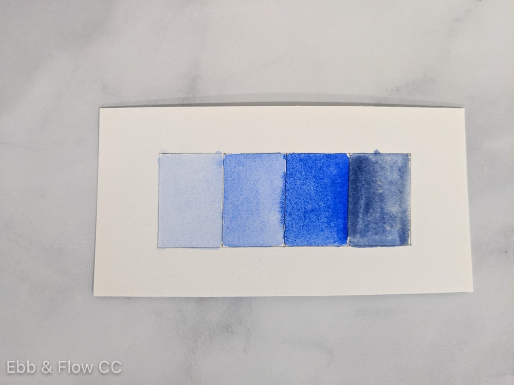 watercolor swatches showing shades and tints of blue, from light to dark