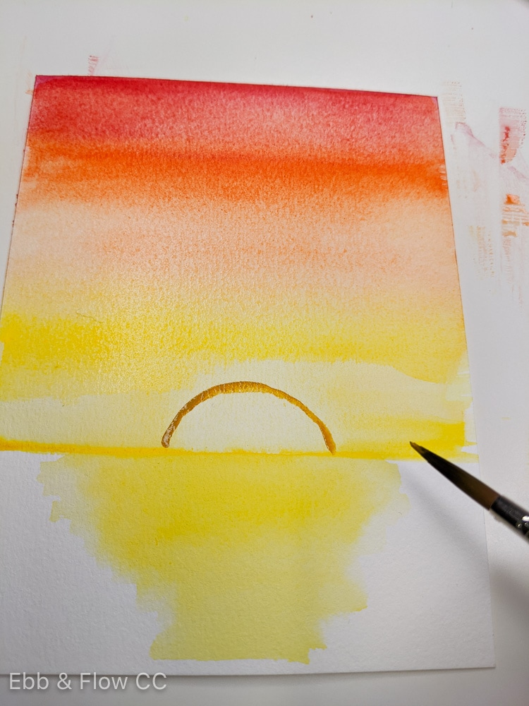 defining the sun with yellow ocher paint