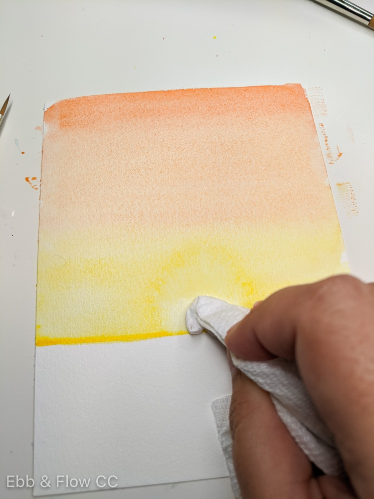 lifting watercolor paint to make a sun