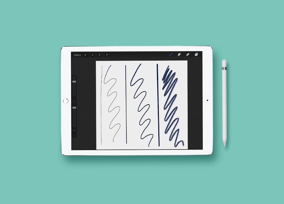ipad mockup with pencil scribbles on aqua background
