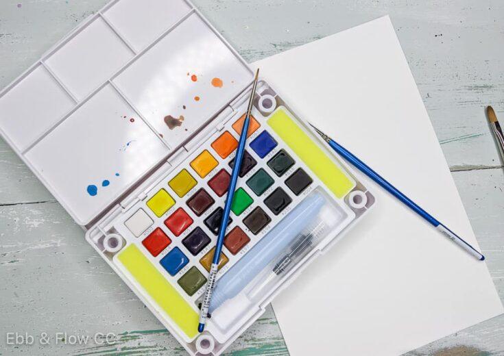 sakura watercolor paint and brushes