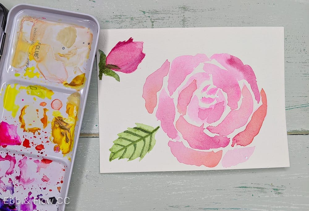 pink watercolor rose with watercolor palette