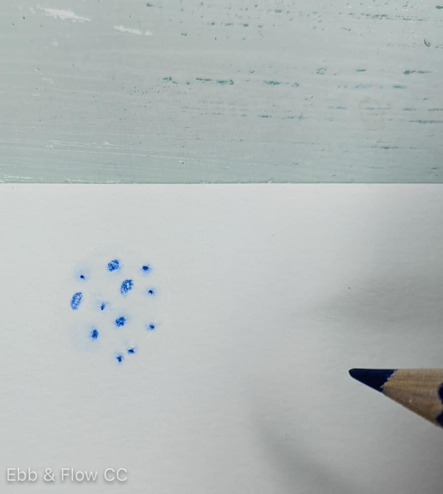 adding textured spots to wet paper