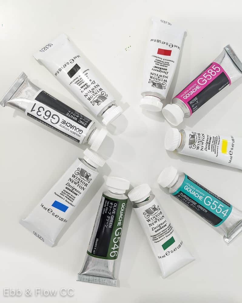tubes of gouache paint in a circle