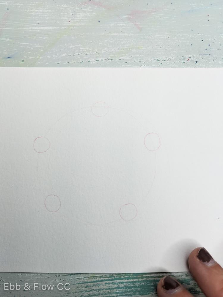 5 small circles drawn on bigger circle