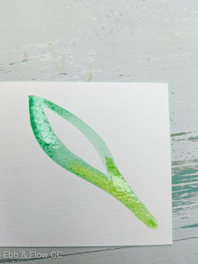dropping yellow into wet green painting of leaf