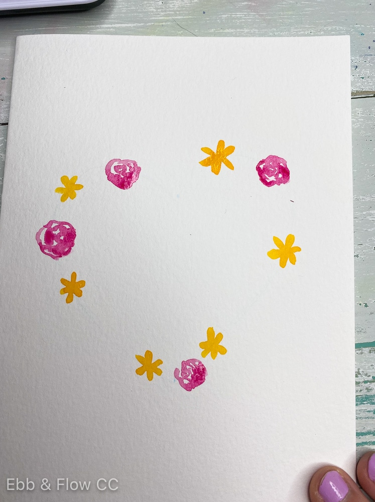 card with yellow flowers and pink roses