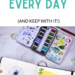 pin image - open sketchbook with paintings and open tin of watercolor paint