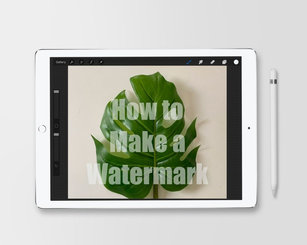 ipad with image of tropical leaf