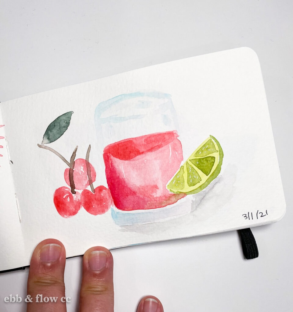 watercolor painting of glass with red drink and fruit