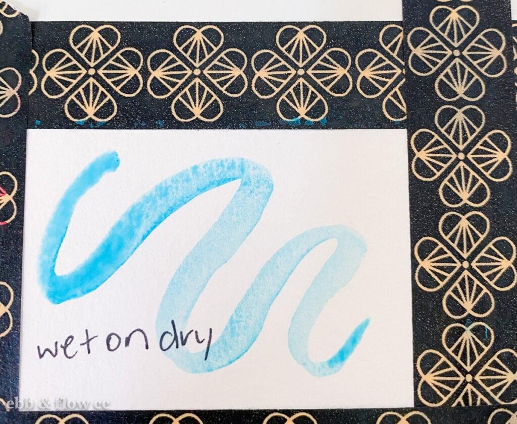 wet-on-dry aqua squiggle on paper