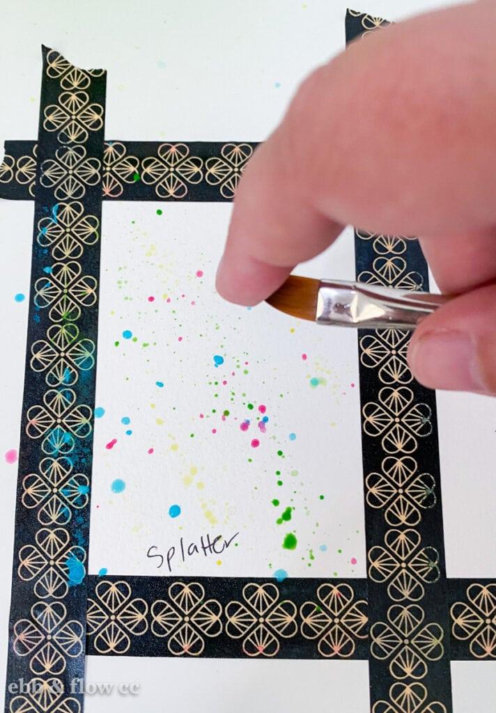 creating splatter with paint brush